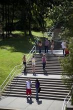 Students taking the stairs.